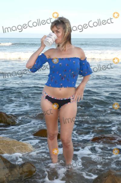 Photo - Showgirls Actress Rena Riffel relaxes at Malibu Beach