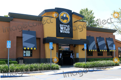 San Bernardino Photo - LOS ANGELES - APR 11  Buffalo Wild Wings Resturant and Signage at the Businesses reacting to COVID-19 at the Hospitality Lane on April 11 2020 in San Bernardino CA
