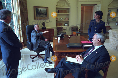 Andy Card Photo - United States President George W Bush meets White House Chief of Staff Andy Card far right US Secretary of State Colin Powell center and National Security Advisor Dr Condoleezza Rice in the Oval Office of the White House in Washington DC on Wednesday December 12 2001Mandatory Credit Eric Draper - White House via CNP