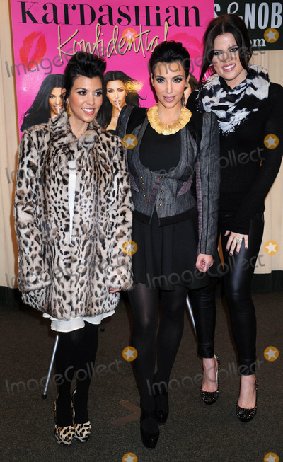 Photos From Kim Kardashian with Kourtney Kardashian and Khloe Kardashian at a signing of 'Kardashian Konfidential'. (NYC)