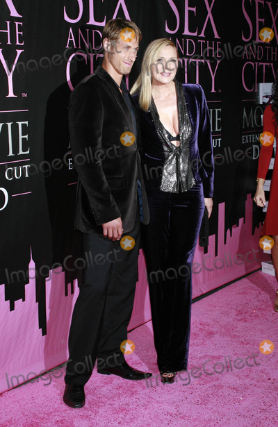 Alan Wyse Photo - Photo by Raoul Gatchalianstarmaxinccom200891808Kim Cattrall and Alan Wyse at the Sex and the City The Movie DVD Launch(The New York Public Library NYC)