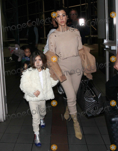 Photos From Kourtney Kardashian and Penelope Scotland Disick are seen at LAX