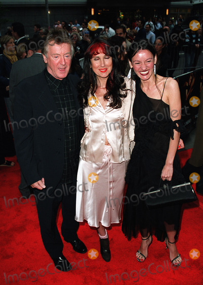 Adrian Lyne Photo - Director Adrian Lyne with his wife Samantha and daughter Amy at the New York premiere of Unfaithful at Ziegfeld Theater New York May 6 2002