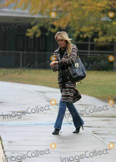 Ali Lohan Photo - Lindsay Lohans mother Dina Lohan took daughter Ali to school in their Long Island neighborhood before paying a visit to the bank and Dunkin Donuts At Dunkin Donuts the ever gracious and delightful Dina bought two cups of coffee for our photographers