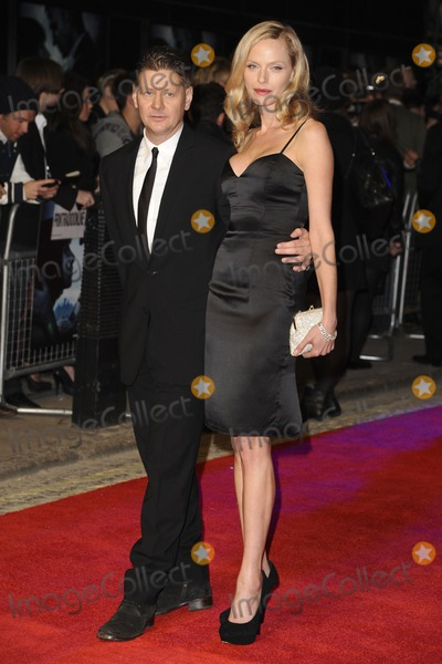 Andrew Niccol Photo - Andrew Niccol and wife Rachel Roberts arrives for the In Time premiere at the Curzon Mayfair cinema London 31102011 Picture by Steve vas  Featureflash