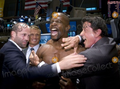 Terry Sylvester Photo - (L-R) From the film The Expendables actors Jason Statham Dolph Lundgren Terry Crews and Sylvester Stallone pictured on the trading floor after ringing the opening bell at the New York Stock Exchange in New York City on August 19 2010