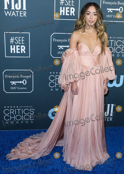 Chloe Bennet Photo - SANTA MONICA LOS ANGELES CALIFORNIA USA - JANUARY 12 Actress Chloe Bennet wearing a Yanina Couture dress arrives at the 25th Annual Critics Choice Awards held at the Barker Hangar on January 12 2020 in Santa Monica Los Angeles California United States (Photo by Xavier CollinImage Press Agency)