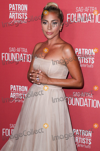 Photo - BEVERLY HILLS LOS ANGELES CA USA - NOVEMBER 08 Singer Lady Gaga (Stefani Joanne Angelina Germanotta) wearing a Christian Dior gown arrives at the SAG-AFTRA Foundations 3rd Annual Patron Of The Artists Awards held at the Wallis Annenberg Center for the Performing Arts on November 8 2018 in Beverly Hills Los Angeles California United States (Photo by Xavier CollinImage Press Agency)