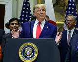 The Used Photo - United States President Donald J Trump makes remarks prior to the signing of the US-Japan Trade Agreement and US-Japan Digital Trade Agreement in the Roosevelt Room of the White House in Washington DC on Monday October 7 2019 Photo Credit Ron SachsCNPAdMedia