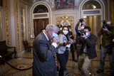 Senator Lindsey Graham Photo - United States Senator Lindsey Graham (Republican of South Carolina) leaves a meeting with former President Trumps defense lawyers and enters the Senate chamber as the third day of the Senate impeachment trial of former President Donald Trump is adjourned for the day at the US Capitol in Washington DC Thursday February 11 2021 Credit Rod Lamkey  CNPAdMedia