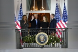 Supremes Photo - United States President Donald J Trump left center and first lady Melania Trump left pose for a photo with Justice Amy Coney Barrett right center and her husband Jesse Barrett right following the ceremonial swearing-in of Justice Barrett as Supreme Court at the White House in Washington DC October 26 2020 Credit Chris Kleponis  Pool via CNPAdMedia