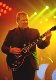 Alex Lifeson Photo - 06 July 2013 - Hamilton Ontario Canada  Alex Lifeson guitarist of iconic Canadian rock band Rush performs on stage at Copps Coliseum Photo Credit Brent PerniacAdMedia