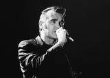 Editors Photo - 03 June 2020 - Morrissey showed his solidarity for Black Lives Matter on Twitter with the hashtag TheShowMustBePaused to support the music communitys Blackout Tuesday While some of Morrisseys fans praised his showing of solidarity others criticized the tweet because of his often controversial political views in the past  File Photo Morrissey performs on stage in 2000 at Hamilton Place Theatre Hamilton Ontario Canada (Editors Note This image has been converted to black and white) Photo Credit Brent PerniacAdMedia