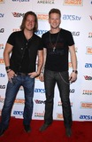 Brian Kelley Photo - 05 April 2013 - Las Vegas NV -  Florida Georgia Line Tyler Hubbard and Brian Kelley  2013 ACM Experience and Big Machine Label Groups  Outnumber Hunger Red Carpet at the Orleans Arena Photo Credit mjtAdMedia