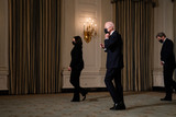 The Specials Photo - United States President Joe Biden departs with US Vice President Kamala Harris and John Kerry the Special Presidential Envoy after an event on climate change in the State Dining Room of the White House in Washington DC January 27th 2021 Credit Anna Moneymaker  Pool via CNPAdMedia