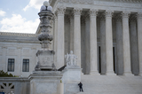 Police Officer Photo - A police officer stands on the steps of the Supreme Court of the United States which began began hearing arguments considering whether or not President Trump can shield his income tax returns from disclosure keeping his private financial records from congressional committees and a New York prosecutor in Washington DC Tuesday May 12 2020 Credit Rod Lamkey  CNPAdMedia