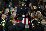 Elijah Cummings Photo - Members of the Congressional Black Caucus pause at the American flag-draped casket of late United States Representative Elijah Cummings (Democrat of Maryland) during a memorial service in National Statuary Hall at the US Capitol in Washington DC US on Thursday Oct 24 2019 Cummings a key figure in Democrats impeachment inquiry and a fierce critic of US President Donald J Trump died at the age of 68 on October 17 due to complications concerning long-standing health challenges Credit Al Drago  Pool via CNPAdMedia