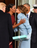First Lady Michelle Obama Photo - First Lady Michelle Obama kisses Melania Trump as the President and President-elect look on at the White House before the inauguration on January 20 2017 in Washington DC  Trump becomes the 45th President of the United States Photo Credit Kevin DietschCNPAdMedia