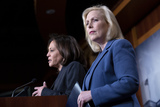 Booker Photo - United States Senator Kirsten Gillibrand (Democrat of New York) right listens as United States Senator Kamala Harris (Democrat of California) speaks during a news conference at the United States Capitol in Washington DC US on Thursday March 12 2020  Gillibrand Harris and United States Senator Cory Booker (Democrat of New Jersey) are working on legislation that would ensure paid sick leave to deal with the Coronavirus  Credit Stefani Reynolds  CNPAdMedia