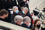 Senator Lindsey Graham Photo - Senator Lindsey Graham a Republican from South Carolina right and Senator John Hoeven a Republican from North Dakota wear protective masks while talking during the 59th presidential inauguration in Washington DC US on Wednesday Jan 20 2021 Biden will propose a broad immigration overhaul on his first day as president including a shortened pathway to US citizenship for undocumented migrants - a complete reversal from Donald Trumps immigration restrictions and crackdowns but one that faces major roadblocks in Congress Photographer Kevin DietschUPIAdMedia