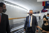 Alabama Photo - United States Senator Tommy Tuberville (Republican of Alabama) talks with reporters as he walks along the Senate subway tunnel on the third day of the Senate impeachment trial of former President Donald Trump at the US Capitol in Washington DC Thursday February 11 2021 Credit Rod Lamkey  CNPAdMedia