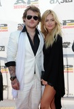 Danny Worsnop Photo - 21 July 2014 - Cleveland OH - Vocalist DANNY WORSNOP of the British band ASKING ALEXANDRIA and his guest attend the 1st Annual 2014 Gibson Brands AP Music Awards at the Rock and Roll Hall of Fame and Museum   Photo Credit Jason L NelsonAdMedia