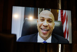 Cory Booker Photo - United States Senator Cory Booker (Democrat of New Jersey) appears on a screen remotely during a Senate Homeland Security and Governmental Affairs Committee confirmation hearing for Neera Tanden director of the Office and Management and Budget (OMB) nominee for US President Joe Biden in Washington DC US on Tuesday Feb 9 2021 Tanden who pledged to work with both parties after drawing sharp criticism from Republicans for sniping at them on social media worked on the Affordable Care Act during the Obama years and was an aide to Hillary Clinton from her time as first lady Credit Ting Shen  Pool via CNPAdMedia