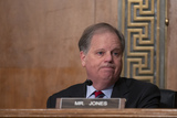Alabama Photo - United States Senator Doug Jones (Democrat of Alabama) listens as Chair of the Federal Reserve Jerome Powell testifies before the US Senate Committee on Banking Housing and Urban Affairs at the United States Capitol in Washington DC US on Wednesday February 12 2020  Credit Stefani Reynolds  CNPAdMedia