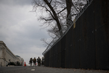 The National Photo - Members of the National Guard walk along Constitution Avenue NW past the US Capitol as preparations are made for the upcoming inauguration of President Joe Biden at the US Capitol in Washington DC Friday January 15 2021 Credit Rod Lamkey  CNPAdMedia