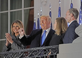The Ceremonies Photo - United States President Donald J Trump left center gestures to guests as he and Justice Amy Coney Barrett right center pose for photos following the ceremony where she took the oath of office to be Associate Justice of the Supreme Court on the Blue Room Balcony of the White House in Washington DC US October 26 2020 First lady Melania Trump looks on from left and Jesse Barrett look on from rightCredit Ken Cedeno  Pool via CNPAdMedia