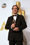 Alexandre Desplat Photo - 22 February 2015 - Hollywood California -Composer Alexandre Desplat winner of the Best Achievement in Music Written for Motion Pictures Original Score for The Grand Budapest Hotel poses in the press room during the 87th Annual Academy Awards presented by the Academy of Motion Picture Arts and Sciences held at the Dolby Theatre Photo Credit Theresa BoucheAdMedia