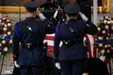 The Used Photo - Members of US Capitol Police salute the body of their colleague US Capitol Police officer William Evans in the Rotunda of the US Capitol in Washington DC on Tuesday April 13 2021 Credit Amr Alfiky  Pool via CNPAdMedia