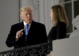 The Ceremonies Photo - United States President Donald J Trump gestures towards Justice Amy Coney Barrett following the ceremony where she took the oath of office to be Associate Justice of the Supreme Court on the Blue Room Balcony of the White House in Washington DC US October 26 2020 Credit Ken Cedeno  Pool via CNPAdMedia