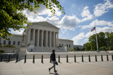 Supremes Photo - A man walks past the Supreme Court of the United States which began began hearing arguments considering whether or not President Trump can shield his income tax returns from disclosure keeping his private financial records from congressional committees and a New York prosecutor in Washington DC Tuesday May 12 2020 Credit Rod Lamkey  CNPAdMedia