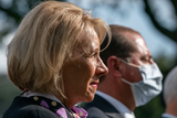 The White Photo - United States Secretary of Education Betsy DeVos listens as US President Donald J Trump gives an update on the Nations Coronavirus Testing Strategy in the Rose Garden of the White House September 28 2020 in Washington DC  Credit Ken Cedeno  Pool via CNPAdMedia