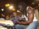 Booker T Photo - March 30 2011 - Atlanta GA - WWE superstar Booker T signed autographs for fans at the Wrestlemania Art Show held at the Fox Theater to raise funds for the Atlanta Childrens Hospital Photo Dan HarrAdMedia