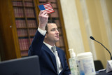 American Flag Photo - Joe Shamess Co-Founder of Flags of Valor holds up an American flag as he testifies before the United States Senate Committee on Small Business and Entrepreneurship on Capitol Hill in Washington DC US on Wednesday June 3 2020  Credit Stefani Reynolds  CNPAdMedia