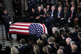 Alex Wong Photo - The flag-draped casket of United States Representative Elijah Cummings (Democrat of Maryland) is seen as the late congressman lies in state during a memorial service at the Statuary Hall of the US Capitol October 24 2019 in Washington DC Rep Cummings passed away on October 17 2019 at the age of 68 from complications concerning longstanding health challenges Credit Alex Wong  Pool via CNPAdMedia