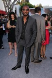Adrian Holmes Photo - Adrian Holmesat the Elysium Los Angeles Premiere Village Theater Westwood CA 08-07-13