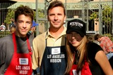 Ashley Edner Photo - Bobby Edner and Ashley Edner with their father Bob at the Los Angeles Mission where a Christmas Meal and Gifts were given to the homeless LA Mission Los Angeles CA 12-24-04