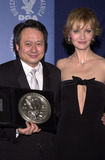 Ang Lee Photo -  Ang Lee and Joan Allen at the 53rd Annual Directors Guild Awards Century Plaza Hotel 03-10-01