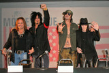 Motley Crue Photo - Motley Crue at the announcement that all the original members of Motley Crue reunite for the Red White  Crue Tour 2005 Better Live Than Dead Motley Crue also perform a mini concert for lucky fans at The Palladium Hollywood CA 12-06-04