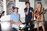 Zach Levi Photo - Zach Levi Joshua Gomez Ashley CampbellChuck Kickoff party presented by Guitar Hero FiveRoosevelt Hotel Pool Los Angeles  CAOctober 10  2009