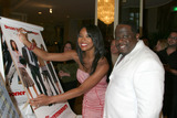 Gabrielle Union Photo - Gabrielle Union and Cedric the Entertainer signing a poster from his new movie The Honeymooners for the silent auction at theFamily Matters BenefitFriends of the Family Annual Gala IHO Cedric the EntertainerRegent Beverly Wilshire HotelLos Angeles CAJune 3 20052005 Kathy Hutchins  Hutchins Photo