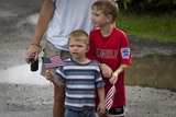 American Flag Photo - Two young boys holding American flags wave at United States President Barack Obamas motorcade as it returns to Obamas vacation compound in Kailua Hawaii after working out at Marine Corps Base Hawaii on Monday December 27 2010 Photo by Kent Nishimura  Pool via CNP-PHOTOlinknet
