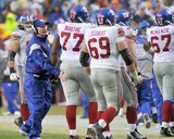 Tom Coughlin Photo - RESTRICTED NO NEW YORK OR NEW JERSEY NEWSPAPERS WITHIN A 75 MILE RADIUS OF NYCLandover MD - November 30 2008 -- New York Giants head coach Tom Coughlin has a pat on the fanny for offensive guard Kevin Boothe (77) as the offense leaves the field after a fouthe quarter series against the Washington Redskins at FedEx Field in Landover Maryland on Sunday November 30 2008  Also pictured are offensive guard Rich Seubert (69) and offensive tackle Kareem McKenzie (67)  The Giants won the game 23 - 7Photo by Ron Sachs-CNP-PHOTOlinknet