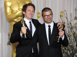 Angus Wall Photo - Kirk Baxter and Angus Wall with the Achievement in Film Editing award received for The Girl with the Dragon Tattoo at the 84th Academy Awards at the Kodak Theatre Los Angeles