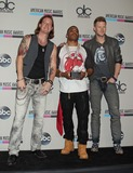 Tyler Hubbard Photo - Photo by REWestcomStarmaxinccom2013ALL RIGHTS RESERVEDTelephoneFax (212) 995-1196112413Nelly Tyler Hubbard Brian Kelly American Music Awards - Press Room at the Nokia Theatre LA Live (Los Angeles CA)
