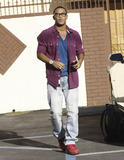 Romeo Miller Photo - Hip hop singer Lil Romeo (aka Romeo Miller) carries his Louis Vuitton backpack and shows off his diamond-studded watch as he arrives at the Dancing with the Stars dance studio to rehearse with his dance partner Chelsie Hightower who also arrived at the studio in her white SUV and waved to photographers Los Angeles CA 031011