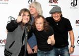 ACDC Photo - ACDC band members Malcolm Young Cliff Williams Angus Young and Brian Johnson at the ACDC Live at River Plate DVD World Premiere at the HMV Hammersmith Apollo London UK 5611